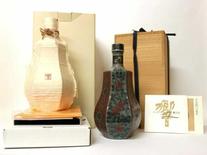 響 35年 十三代今右衛門作 色絵薄墨草花文洋酒瓶